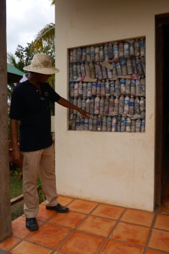 Beyond Escape built the building out of plastic bottles. Villagers collect the bottles, fill them with trash (which is an eyesore in the village), and turn them in for extra rice (12 bottles) or a second-hand bicycle (1000 bottles). It's ingenious.