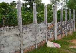 This wall is being built from plastic bottles.