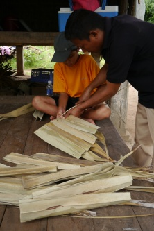 Our guide, Sokha, gives Aidan a lesson on wall panel construction.