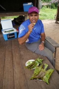 Neerav prepares to try fish paste/red ant dish.