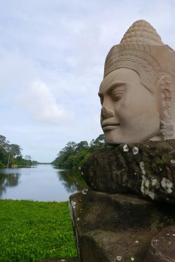 A hand-dug moat surrounds Angkor Thom