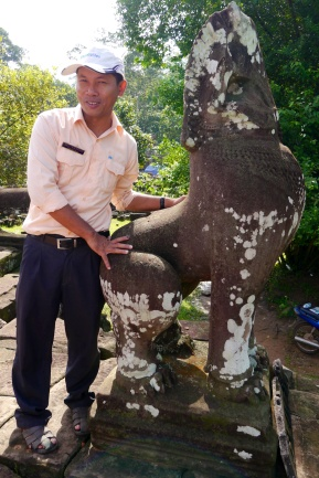 Our guide, Yanos, shows us the lions that guard the temple entrance.