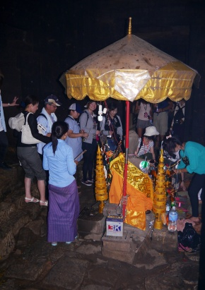 Buddhists worshipping inside Bayon Temple