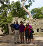 Neerav, Nathan, Aidan, and Shellie in front of the east entrance to Ta Prohm