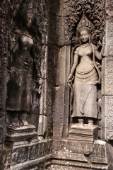 The statue on the right is supposed to be King Jayavarman VII's queen.