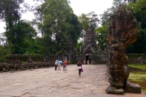 This is the entrance to Preah Khan, built by King Jayavarman VII to honor his father. He built Ta Prohm to honor his mother.