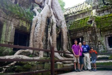 Nathan, Shellie, Neerav, and Aidan in front of a Banyan tree that's taken over this corner of the temple