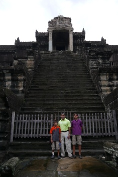 Aidan, Neerav, and Nathan in front of steps to central tower of Angkor Wat