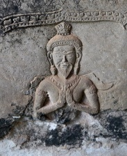 This carving of Shiva meditating is repeated throughout Angkor Wat's gallery.
