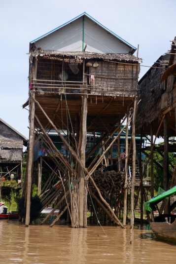 The homeowners store fishing nets and firewood on the lower part of the house.