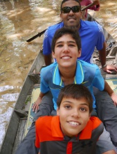 We transfer to a small canoe and row through the Flooded Forest.