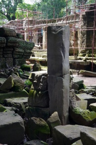 To the left of the tall pillar, you can see where the restoration team is slowly trying to piece together a puzzle.