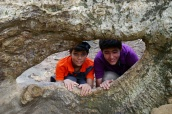 Aidan and Nathan inside a Banyan tree root