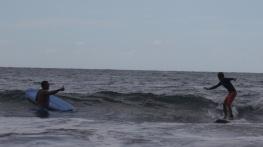 Neerav cheers Aidan's surfing success