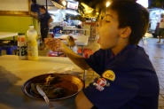 Aidan votes the crepe at the Roulettes the best of the trip!