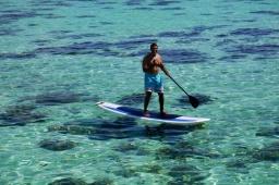 Neerav is looking very Polynesian on his paddle board.