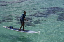 Nathan masters the paddle board.