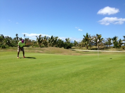 Neerav going for the long putt on Hole 1 at Moorea Green Pearl Golf Course.