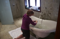 How glamorous! Shellie is doing laundry in the hotel bathtub.