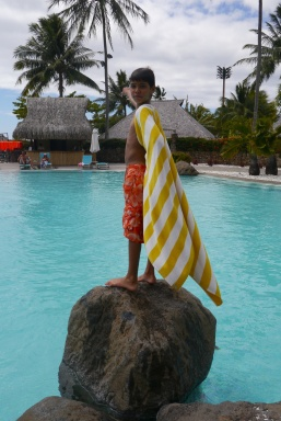Aidan and his cape poolside