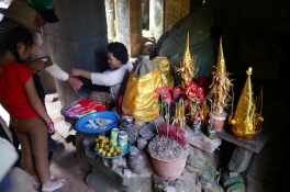 Vendor is selling incense inside the temple.