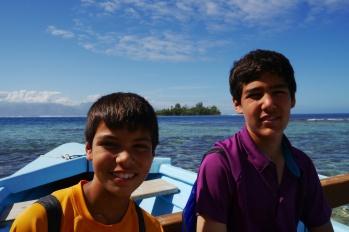 Aidan and Nathan on outrigger canoe headed to Lagoonarium