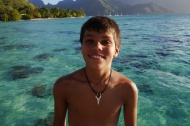After swimming with sharks, Aidan bought this shark tooth necklace. With his tan, he's looking very Polynesian.