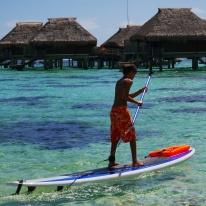 Aidan takes one last paddle board ride.