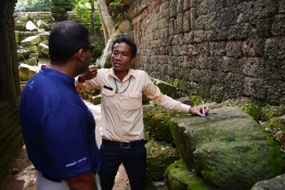 Our guide, Sarith, shows how men were able to drill holes and then using wood dowels, move the rocks.