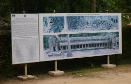 This sign shows the before and after photos of restoration.