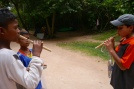 These boys were selling wood flutes with grass cases for $1. Aidan bought one and got a quick lesson.