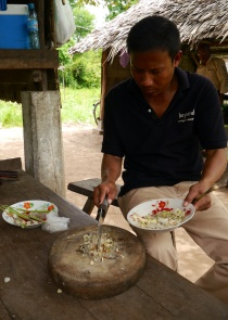 To the fish paste, our guide Sokha adds chopped red chillies, ginger, garlic, and lemongrass.